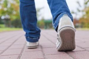 + sneakered feet on sidewalk Blog april 14 13409511_s