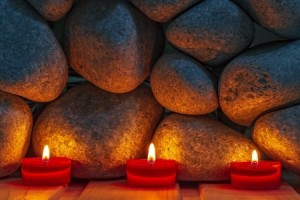 + three candles in front of rocks 25035826_s