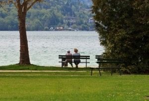 two people sitting on a bench, talking about the future