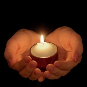 + hands holding tealight FB Sept 14 11205410_s